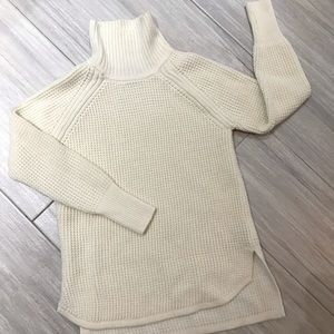 Cream colored, super soft cable knit sweater